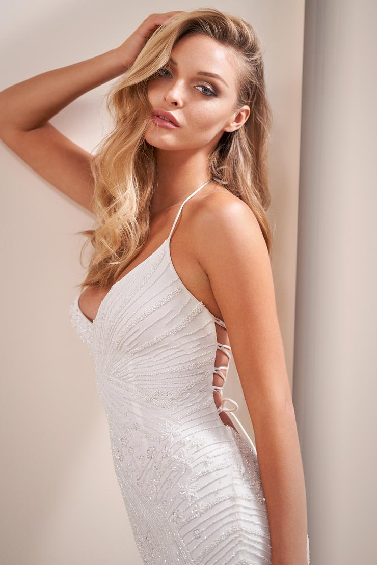 Fit and flare weding dress with decadent beading and open corset back