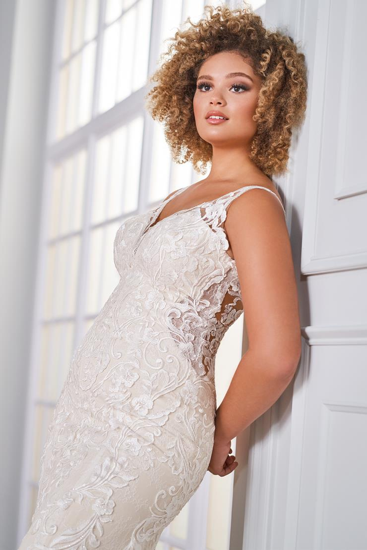 Dawes Sleeveless lace wedding dress with open back, plunging neckline, and lace train