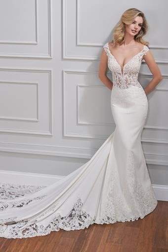 Alexandre Crepe fit and flare wedding dress with sheer bodice, plunging neckline, and illusion lace back